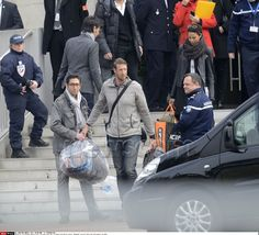 """Alain Bernard. French sports stars,crew from the ill-fated reality TV series , and relatives outside the Honours Pavilion at Paris Roissy-Charles-de-Gaulle airport, after the arrival from Argentina. French sports stars and crew from the ill-fated reality TV series """"Dropped"""" landed in France on March 14, as experts investigate this week's helicopter crash that killed 10 people, including three top French athletes,"""