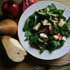 "Pear and Pomegranate Salad | ""Loved the dressing. Light and flavorful. I made this for Thanksgiving and added candied pecans. Everyone loved it."""