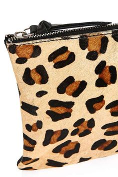Look to clean lines to complete your look with this chic contrast leather purse in animal print. A simple silhouette with faux-pony hair detailing to the front panel, it features a secure gold zip-top closure. #Topshop