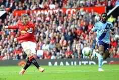 Manchester United striker Wayne Rooney opens the scoring in the fifth minute...