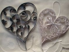 Paper crafts - Paper Quilling ~ Hearts from http://www.femme2decotv.com/fiches-techniques/cadres-en-carton_1008.html
