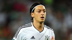 Club confirms record deal as 24-year-old midfielder Mesut moves from Real Madrid to Emirates Stadium on a long-term contract