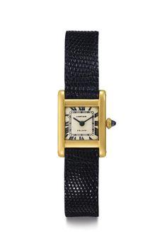 Kim Kardashian West Buys Jackie Kennedy's Cartier Watch At Auction