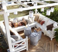 Cozy outdoor patio- love the hanging lanterns