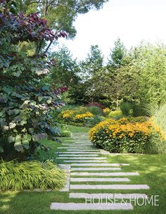 Add a meandering walkway to your garden, laying stone or pavers in an off-kilter pattern, for a welcome dose of romance. | Photographer: Virginia Macdonald | Designer: Mark Hartley