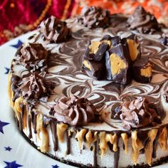 Raw peanut butter and chocolate ganache cheesecake with raw chocolate 'buttercream' icing, topped with raw peanut butter cups.