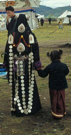 Mother and Daughter in Litang Horse Festival... Litang, Kham, Tibet.  Khampa Festival.  China #MinoritiesCulture