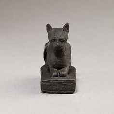 Cat on base inscribed for Bastet and an offerer Period: Late Period–Ptolemaic Period Date: 664–30 B.C. Geography: From Egypt Medium: copper alloy Dimensions: L. 0.054m x H. 0.048m Credit Line: Gift of Darius Ogden Mills, 1904 Accession Number: 04.2.476MMA