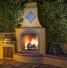 A husband and wife spend just 30 on stacked stones off for Spanish style outdoor fireplace