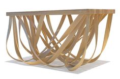 Coffee table by Yvette Cox. Looks like the feet are draped from the table...like ribbons, or fettuccine, or jellyfish tentacles.