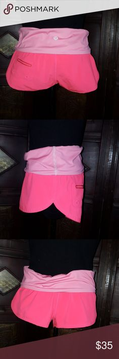 Lululemon Athletic Runing Shorts size 4 Pre-owned runing shorts in very good condition. Color is fluorescent orange with pink and white stripes waist. Please ask any question before purchasing this shorts. lululemon athletica Shorts Skorts