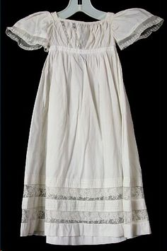Dress, baby's, off-white cotton, butterfly cap sleeves with white lace trim, 1827-1828