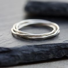 Interlocking ring made of 4 tiny bands - sterling silver, stackable
