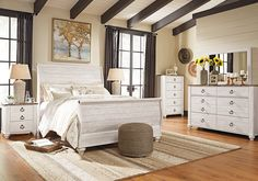 The Willowton queen sleigh set is the ultimate statement piece for your coastal cottage or shabby chic inspired retreat. Whitewashed finish on the drawers and sides is wonderfully easy on the eyes. Paired with the unique plank-style top, it's a driftwoody look that has our minds drifting away to beachy-keen escapes.