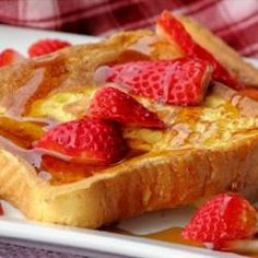 Fluffy French Toast (secret ingredient in the egg bath)  I will never make regular french toast again!!  YUM