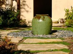 Desert, Xeriscape and Rock Gardens: Set a focal point on an axis stemming from the house. This fountain and path is deliberately aligned with the doorway. Design by Kerry Burt. From DIYnetwork.com