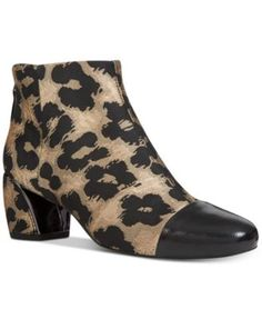 Nine West Joannie Booties $119.00 Metallic flash and a sleek profile bring sophistication to any look in these Joannie booties from Nine West.