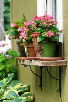 Pots on a repurposed shelf make most of vertical space, are easily accessible and add charm to the house exterior.  The Micro Gardener