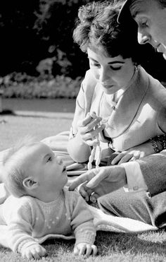 Elizabeth Taylor ,her husband, Michael Wilding, and their son, Michael ,in Hyde Park, London. Oct, 1953