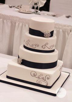 4 tiered white, silver and navy wedding cake by Cakeity Cakes. www.cakeitycakes.ca
