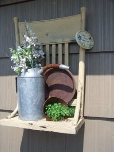 Repurposed Old Chair ... am I crazy for liking this ??? don't answer, I know the answer already :)  but I do - haha!!!  I also like this and think it would be adorable on the side of my barn in the garden or on the front instead of benches.
