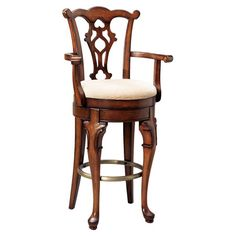 Birch arm barstool with an upholstered seat and openwork back design. Includes a self-returning memory swivel and cabriole legs with an antique brass finishe...