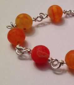 Orange Dragon Vein Agate Bracelet by wrappedandwired on Etsy