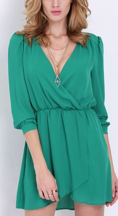 This gorgeous long sleeve v neck wrap fornt dress is such a lovely shade of green.