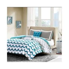 full/queen bedding set . The bright and refreshing blues and taupe/gray colors in this patterned comforter set are neutral enough to work for a boy's or girl's bedroom.
