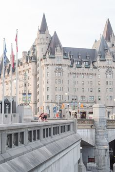 urban downtown ottawa engagement photos in front of chateau laurier