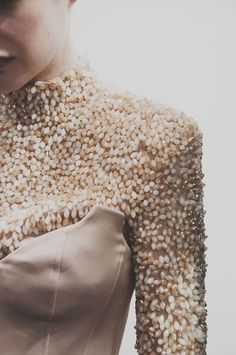 Cream and gold teardrop beads backstage at H by Hakaan Yildirim AW15 LFW. See more here: http://www.dazeddigital.com/fashion/article/23805/1/h-by-hakaan-yildirim-aw15