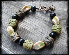 Brown green and black beaded bracelet  by TwilightOfMySanity