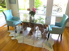 Head chairs are a HomeGoods find. They definitely add a pop of color to this breakfast room!