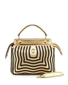 Cookie Lyon (Taraji P. Henson)) carries a Fendi Dotcom Click Small Wave  Chain Crossbody Bag in Gold Black accc65cbf7531
