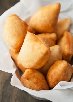 sopaipilla recipe:  It's a simple fry bread served as hot pillows of dough with a bear-shaped bottle of honey on the side and little fanfare | use real butter