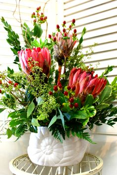 Beautiful Pink Protea and Hypericum Berry arrangement in cute snail vase! Call or stop in now, our information is located in the bio.