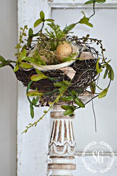 Bird's Nest on candlestick.......I should do some of these.  I have plenty of white candlesticks!