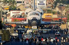 Space Shuttle Endeavour cruising through the streets of the best city in the world