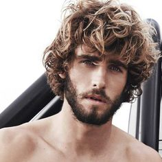 Alex Libby with medium length curls plus a beard.