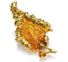 Leaf brooch. Rene Lalique (1860 -1945). Gold, plique-à-jour enamel, sapphire. Circa 1900. Dimensions: 2 1/8 x 1 in. (5.5 x 2.5 cm) Via Sotherbys.