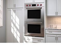 Wolf M-Series double wall oven in white kitchen.