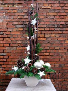 35 Fancy Outdoor Holiday Planter Ideas To Enliven Your Christmas Day - GoodNewsArchitecture Christmas Flower Arrangements, Christmas Flowers, Christmas Centerpieces, Xmas Decorations, Christmas Time, Christmas Wreaths, Christmas Crafts, Christmas Ornaments, Simple Christmas