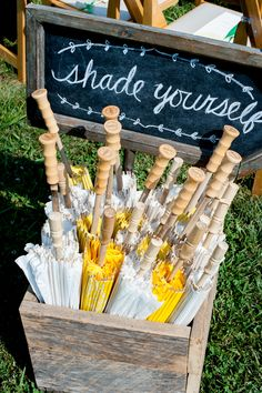 White & Yellow Parasol Favors for Guests at Outdoor Ceremony | Photography: Realities Photography. Read More: http://www.insideweddings.com/weddings/green-yellow-rustic-farm-wedding-in-north-carolina/500/
