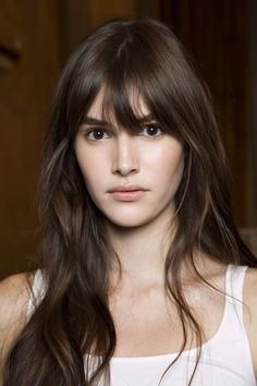 Rounded bangs that are longer in the center work perfectly with super-long hair.