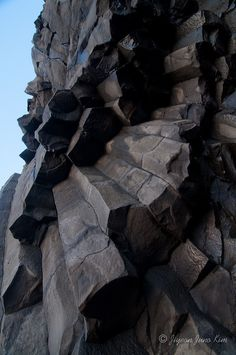 Reynisfjara beach with basalt formations and ocean carved caves