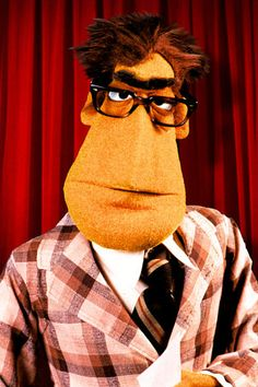 The Newsman is the weary, bespectacled Muppet News Flash anchor on The Muppet Show, debuting in the second episode. The Newsman always tried to deliver the news with accuracy, but was visibly flummoxed on camera by the day's latest bizarre story or interview. Interviews were a more common part of the News Flash in its first season, where the interviewees were portrayed by the show's guest star. From the second season onward, he suffered from a nasty streak of bad luck that usually…