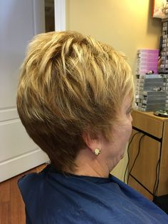 Short hair cut, blond on blonde hair color and highlights, layered and cut with lots of texture