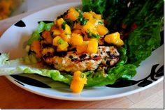 Thai Chicken Burgers with Mango Salsa are wrapped in lettuce instead of a bun, topped with mango salsa and spiked with a spicy peanut sauce. So tasty! | iowagirleats.com