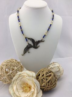 Feed the Birds Antique Bronzed Bird with Simulated Lapis via Etsy shop LoveLeaPiecesbyMe