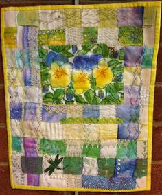 Elizabeth Creates hand painted pansy scene with woven    back ground using vintage fabrics and hand dyed laces and trims, hand stitch and bead work